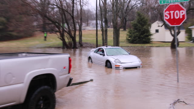a good samaritan pulls a stalled car and its driver from flash flood waters at fountain drive and west 8th street near the intersection of fountain... - tow truck driver stock videos and b-roll footage