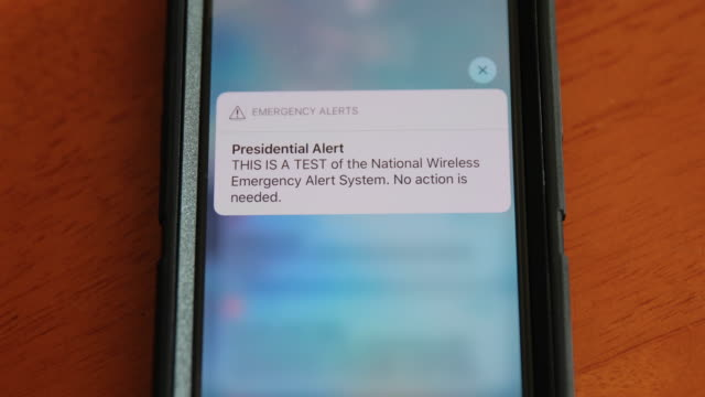 a presidential emergency text alert system test during the donald j trump presidency goes out to cell phones across the united states at 218 pm... - alertness stock videos & royalty-free footage