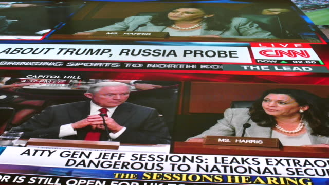 bloomington, indiana, usa: attorney general jeff sessions is shown on televisions in the indiana university media school being questioned by sen.... - attorney general stock videos & royalty-free footage