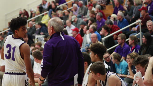 bloomington high school south basketball coach jr holmes coaches against northview high school during his recordbreaking 807th indiana high school... - record breaking stock videos & royalty-free footage
