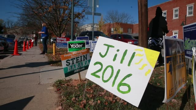 campaign signs including one for jill stein fill a grassy area 50 feet from a line of voters on the last day of early voting at monroe county... - jill stein stock videos and b-roll footage