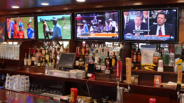 One television at Yogi's Grill sand Bar is tuned to the former FBI director James Comey giving testimony to the Senate Intelligence Committee on...