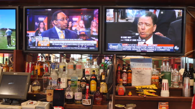 one television at yogi's grill sand bar is tuned to the former fbi director james comey giving testimony to the senate intelligence committee on... - testimony stock videos & royalty-free footage