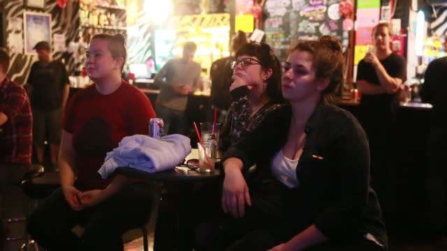 patrons at the back door gay bar watch vice presidential candidates tim kaine democrat running with hillary clinton and mike pence republican running... - television show stock videos & royalty-free footage
