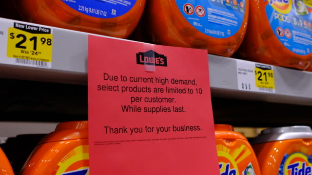 bloomington, indiana, usa: purchases of laundry detergent, and other items, are limited because of panic buying, and hoarding, during the coronavirus... - laundry detergent stock videos & royalty-free footage