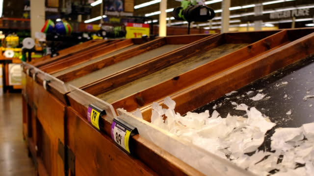 stockvideo's en b-roll-footage met shelves are cleared of potatoes and onions at a kroger in bloomington just before the store is shutting down for the night at midnight friday march... - shelf