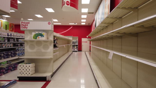 stockvideo's en b-roll-footage met shelves are cleared of toilet paper at a target store in bloomington just before the store is shutting down for the night at midnight friday march 13... - plank meubels