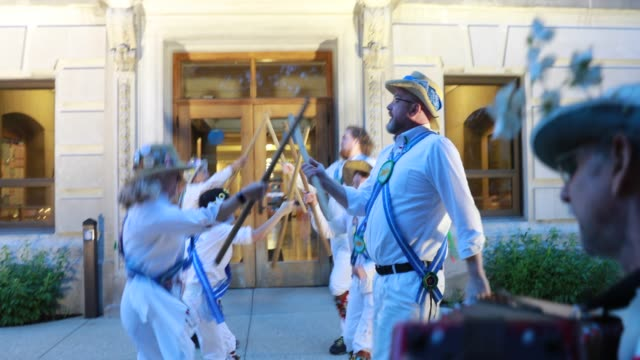 the bloomington quarry morris dancers perform on the south side of the monroe county courthouse at sunrise may 1 2019 the group traditionally... - may day international workers day stock videos & royalty-free footage