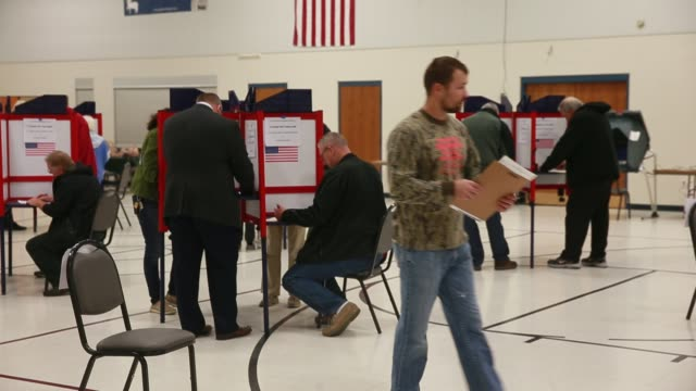 voters cast their ballots at st john's catholic church on election day 2016 the church had a line of over 100 voters in line by 545 am and the polls... - united states presidential election stock videos & royalty-free footage