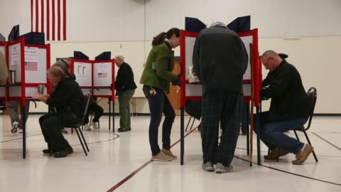 bloomington, indiana, usa: voters cast their ballots at st. john's catholic church on election day 2016. the church had a line of over 100 voters in... - 2016 stock videos & royalty-free footage
