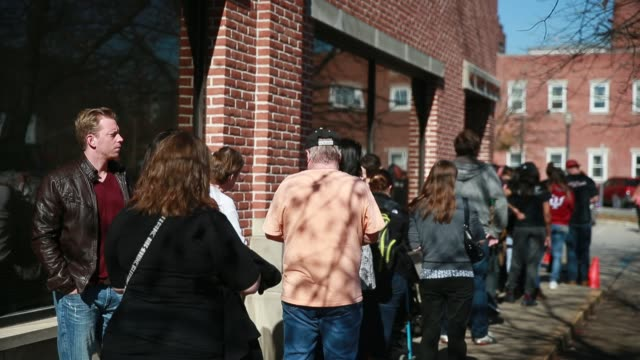 bloomington, indiana, usa: voters line up on the last day of early voting at monroe county indiana's election central. early voting ended at noon. - last day stock videos & royalty-free footage