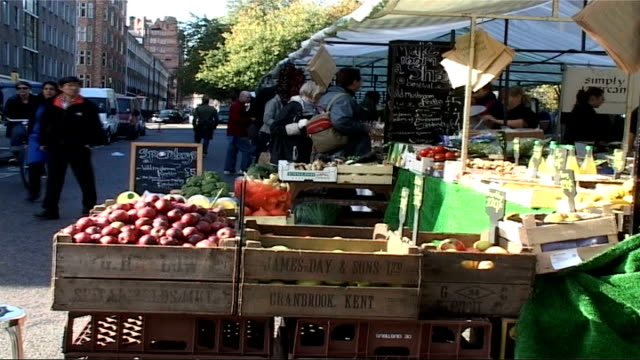london bloomsbury ext market stalls at festival actor dressed as charles dickens story sot man on unicycle in chopping centre - charles dickens stock videos & royalty-free footage