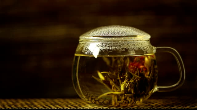 blossoming tea. - chinese tea cup stock videos and b-roll footage