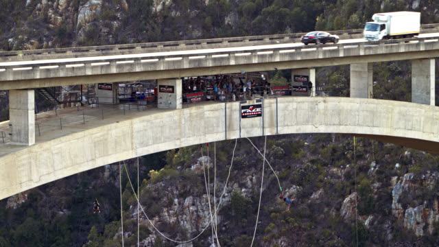 bloukrans bridge bungee  / natures valley sa / shot-4: person jumps - close static shot - world record stock videos and b-roll footage