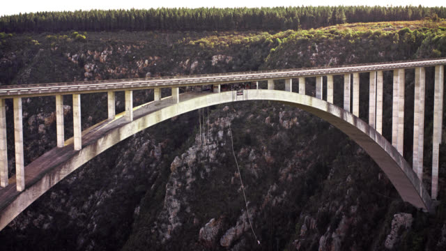 bloukrans bridge bungee  / natures valley sa / shot-5: person jumps - 60fps high-speed - south africa stock videos & royalty-free footage