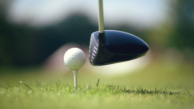 blow to the golf ball - golf ball stock videos & royalty-free footage