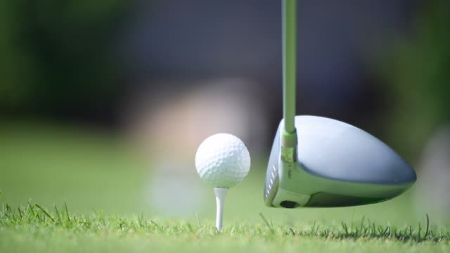 blow to the golf ball - golf stock videos & royalty-free footage