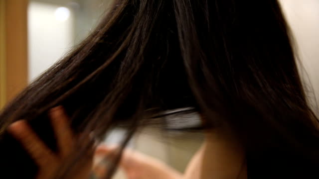 blowdrying her hair - black hair stock videos & royalty-free footage