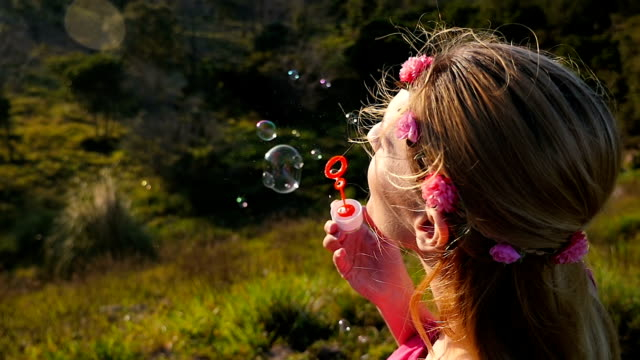 Blowing bubbles with happiness
