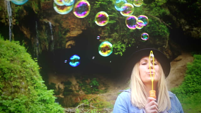 blowing bubbles with happiness - blonde hair stock videos & royalty-free footage
