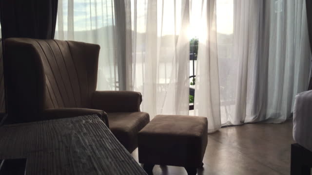 blowing curtain with a armchair. - balcony stock videos & royalty-free footage