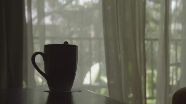 blowing curtain with a coffee cup - armchair stock videos & royalty-free footage