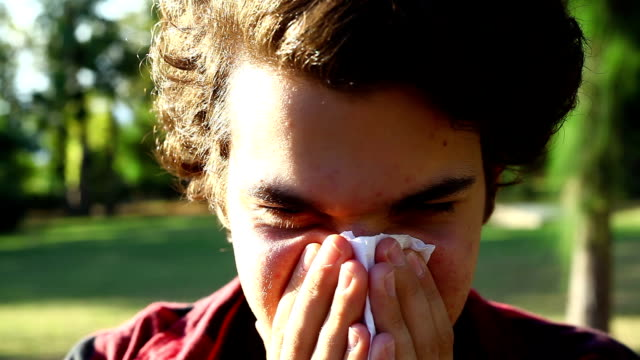 blowing nose (hd) - facial tissue stock videos & royalty-free footage