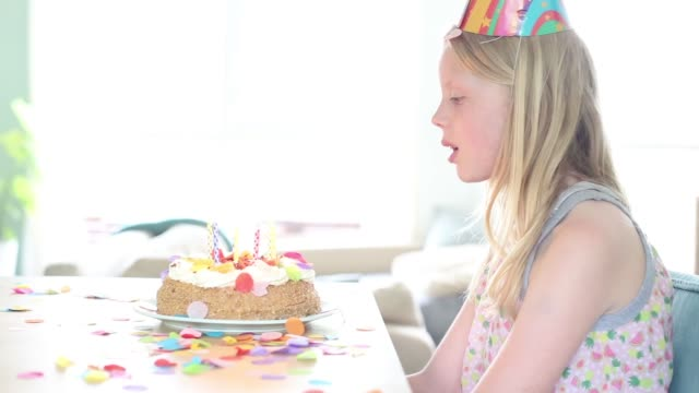 blowing out the candles - seitenansicht stock-videos und b-roll-filmmaterial