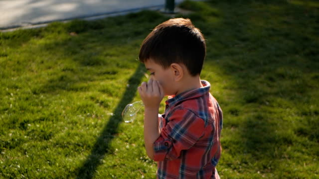 blowing soap bubbles - nursery school child stock videos & royalty-free footage