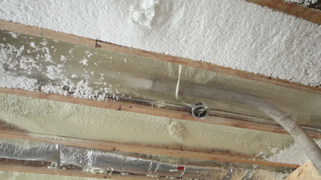 blown insulation being installed between floor joists - insulator stock videos & royalty-free footage
