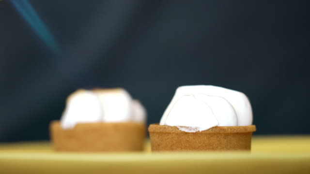 LA CU Blow-torching lemon meringue tartlets