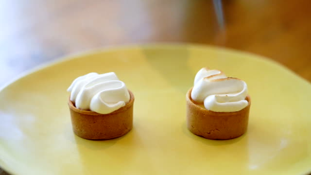 slomo blow-torching lemon meringue tartlets - meringue stock videos & royalty-free footage