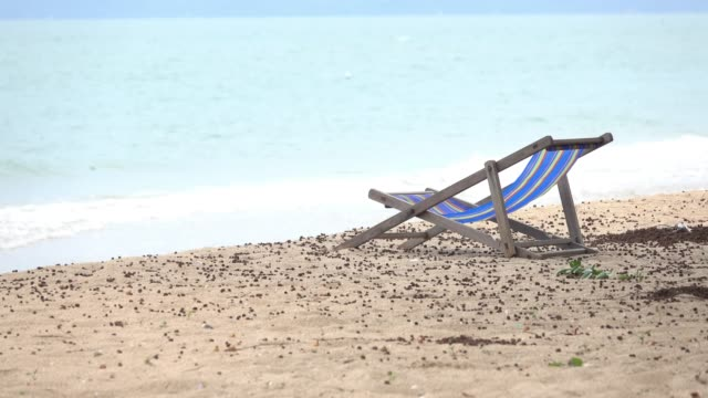 blue and colorful striped wooden beach chair - deck chair stock videos & royalty-free footage