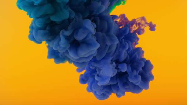 slo mo ld blue and green colour creating a cloud underwater - impact stock videos & royalty-free footage
