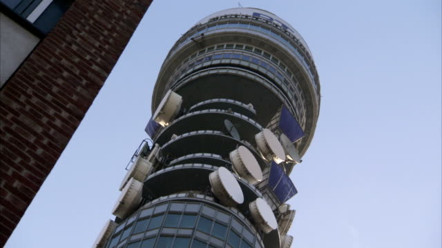 blue and white microwave dishes on bt tower. available in hd. - microwave tower stock videos and b-roll footage