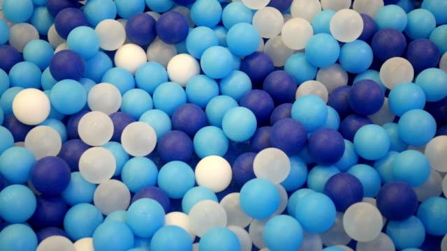 blue and white plastic balls