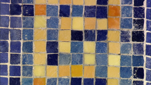 blue and yellow tiles form a mosaic. - mosaic stock videos and b-roll footage