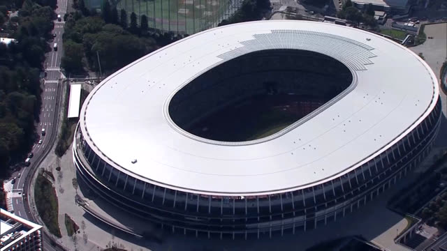 blue autumn sky could be seen above the new national stadium on oct. 10, which marked 55 years since the opening ceremony for the 1964 olympics.... - オリンピック大会点の映像素材/bロール