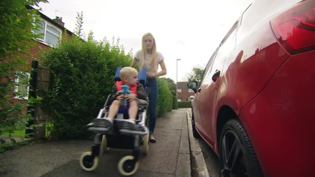 blue badge parking permits to be extended to those with hidden disabilities uk west yorkshire leeds blue badge disabled parking / case study family... - car stock videos & royalty-free footage