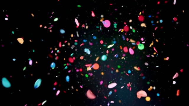 vídeos de stock e filmes b-roll de slo mo ld blue balloon popping and releasing glitter and confetti into the air - colorido