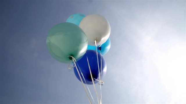 Blue balloons in sky
