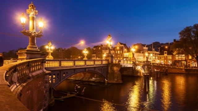 blue bridge in amsterdam, time lapse (4k) - amsterdam stock videos & royalty-free footage