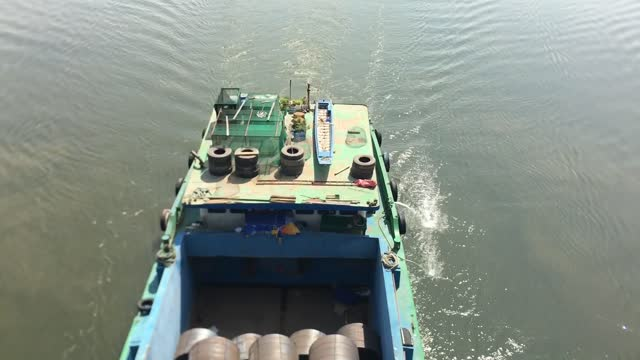 blue cargo barge, saigon river, ho chi minh city. - barge stock videos & royalty-free footage