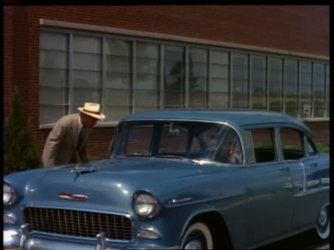 1955 blue chevrolet pulls up to waiting man, he gets in + they drive away - general motors stock videos & royalty-free footage