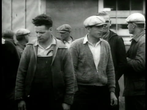 blue collar male unemployed workers standing sitting outside building ext american federation of laborers building ms president afl william green... - 1937 stock videos and b-roll footage