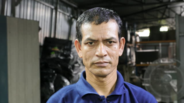 Blue Collar Worker at his Factory