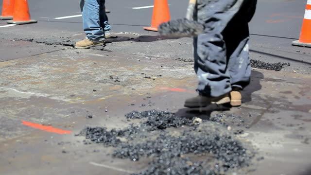 Blue Collar Worker repairing road in New York City