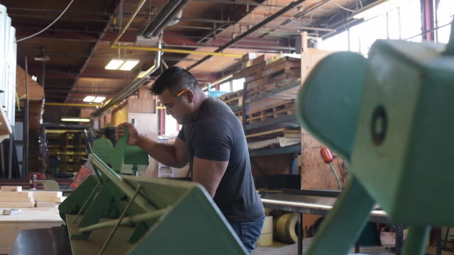 blue collar worker using machine to bend metal - aluminum sheet stock videos and b-roll footage