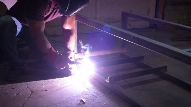 blue collar worker welding - one mid adult man only stock videos & royalty-free footage