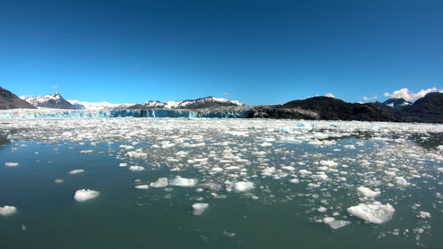 blue colored melting glacial ice ocean inlet alaska - inlet stock videos & royalty-free footage